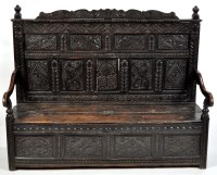 Lot 1073-A 17th Century carved oak settle, the back...
