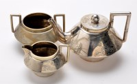 Lot 605 - A three-piece bachelors tea service, in the...