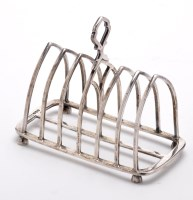 Lot 619 - A George VI seven bar toast rack, by Mappin &...