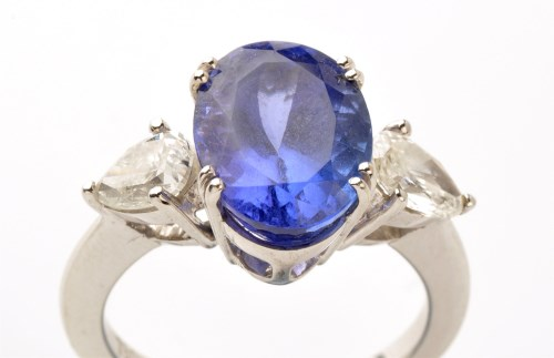 Lot 914-A tanzanite and diamond ring, the oval facet cut...