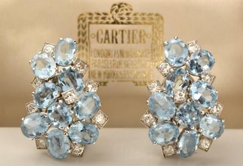 Lot 932-Manner of Cartier: a pair of Art Deco aquamarine...