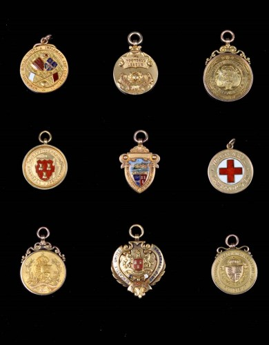 Lot 377-A collection of football medals awarded to...