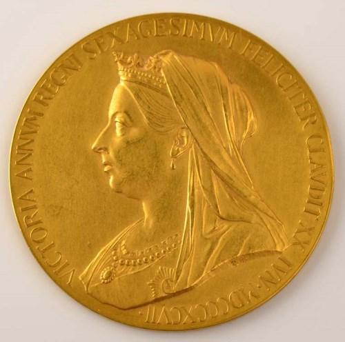 Lot 721-A gold medal commemorating Queen Victoria's...