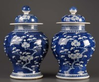 Lot 18 - A pair of blue and white covered baluster...