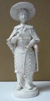 Lot 20 - A Dehua figure of a lady archer, 18th/19th...