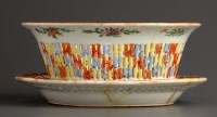 Lot 28 - A Canton enamel basket and stand, painted in...