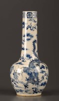 Lot 33 - A blue and white vase, painted with dragons...