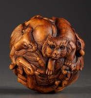 Lot 51 - A carved and stained wooden 'Zodiac' ball,...