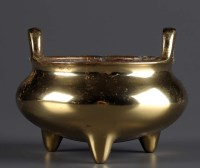 Lot 54 - A bronze censer, of baluster form, with twin...