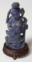 Lot 56 - A carved lapis lazuli figure of Guanyin, shown...