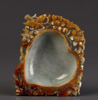 Lot 57 - A jade bowl of peach form, surrounded by...