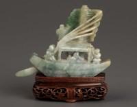 Lot 60 - A Jade model of a boat, 20th Century, raised...