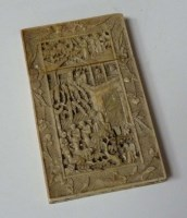 Lot 64 - An ivory card case, finely carved with figures...