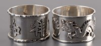 Lot 66 - Two Chinese silver napkin rings, by Wang Hing,...