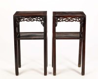 Lot 69 - Two similar carved Chinese hardwood tables, of...