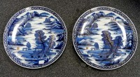 Lot 73 - A pair of plaques, painted in blue and gold...