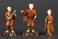 Lot 76 - Three carved ivory and wood okimono, each with...