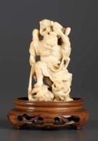 Lot 78 - A carved ivory okimono of Shoki and three Oni...