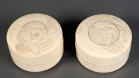 Lot 81 - Two carved ivory boxes, both with different...