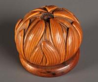 Lot 83 - A carved vegetable ivory pomander in the form...