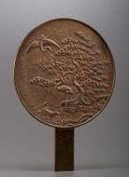 Lot 85 - A bronze mirror, of typical form, having a...