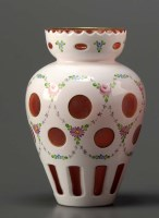 Lot 97 - A ruby and white cut and cased vase, of...