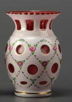 Lot 98 - A ruby and white cut and cased vase, of...