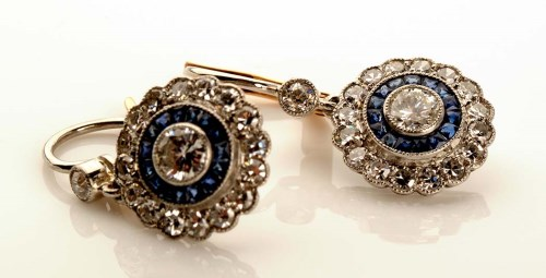 Lot 870 - A pair of sapphire and diamond earrings, of...