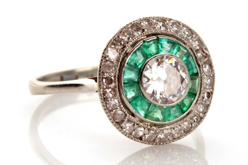 Lot 915-An Edwardian diamond and emerald ring, the...