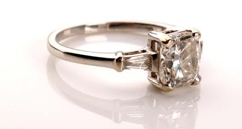 Lot 972-A single stone diamond ring, the cushion cut...
