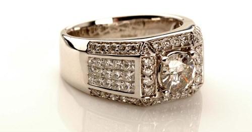 Lot 979 - A gentleman's diamond dress ring, the...