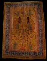 Lot 1233-An early 20th Century Ushak carpet, the central...