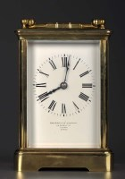 Lot 1274-A French brass carriage clock, enamelled roman...