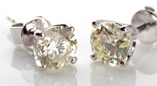 Lot 1049-A pair of diamond ear studs, the brilliant cut...