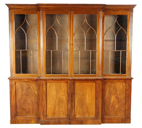 Lot 1329 - A Georgian mahogany breakfront bookcase with...