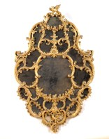 Lot 1362-† A late 18th Century carved giltwood and moulded ...