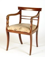 Lot 1858-A late Regency mahogany open arm dining chair...