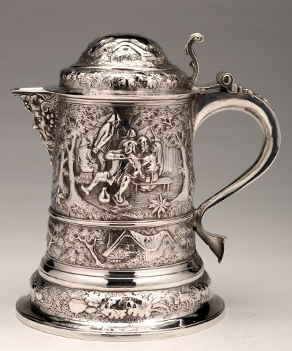 Lot 630-An embossed silver jug, converted from a George I ...