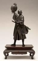 Lot 448-A bronze figure of a Samurai, holding a lantern...
