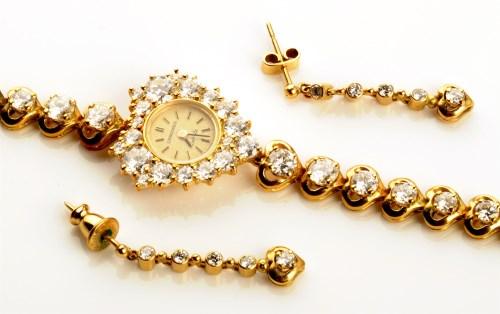 Lot 704-A Longines diamond set 18ct. gold cased lady's...