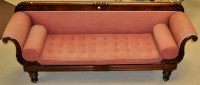 Lot 1343-A late Regency mahogany sofa, with carved rail...