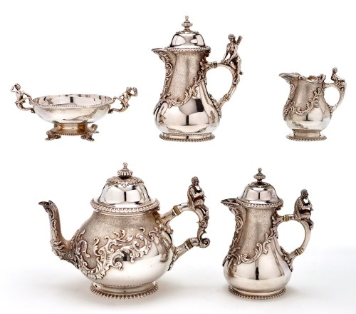 Lot 588-An early 20th Century five-piece tea and coffee...