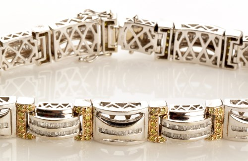 Lot 758-A yellow and white diamond bracelet, the fourteen ...