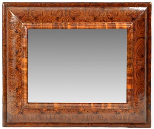 Lot 1211-An oyster veneered wall mirror, the rectangular...