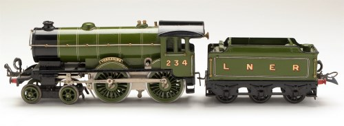 Lot 511-A clockwork locomotive and tender, by Hornby,...