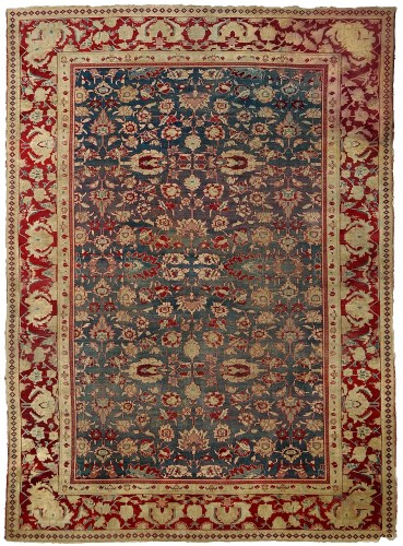 Lot 1235 - An Agra carpet, the field with blue ground and...