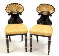 Lot 1314-A pair of late Regency parcel gilt hall chairs,...