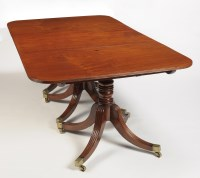 Lot 1344-A George III mahogany three-pedestal dining table,...