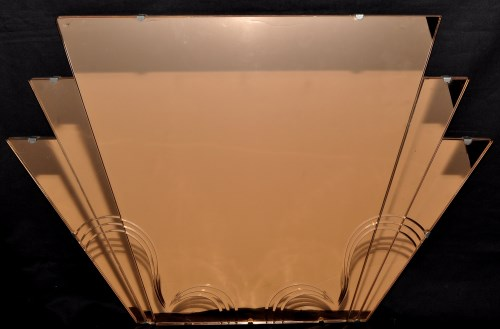 Lot 1211-An Art Deco rose tinted wall mirror, 76 x 52cms....