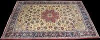 Lot 817 - A Tabriz carpet, the central rosette on ivory...
